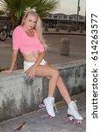 beautiful blond girl on roller... | Shutterstock . vector #614263577