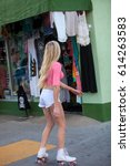 beautiful blond girl on roller... | Shutterstock . vector #614263583
