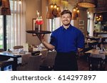 waiter with alcoholic cocktail... | Shutterstock . vector #614297897