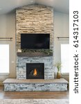 modern stacked stone fireplace | Shutterstock . vector #614317103