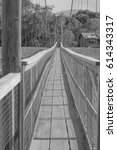 Small photo of Walk Across: looking across the historic suspension bridge in Old Hanapepe Town, in black and white, on Kauai, Hawaii, mid morning, on March 28, 2017