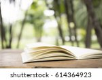 open book on wood planks over