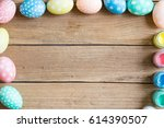 easter eggs with wood background | Shutterstock . vector #614390507