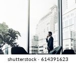 businessman using mobile phone... | Shutterstock . vector #614391623