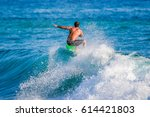 riding the waves. costa rica ... | Shutterstock . vector #614421803