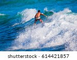 riding the waves. costa rica ... | Shutterstock . vector #614421857
