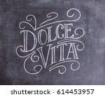 dolce vita hand drawn lettering ... | Shutterstock . vector #614453957