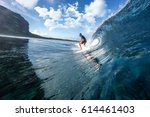 muscular surfer riding on big...   Shutterstock . vector #614461403