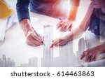 double exposure of hands of... | Shutterstock . vector #614463863