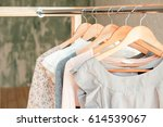 female clothes on clothing rack.... | Shutterstock . vector #614539067