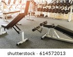 bench in gym with dumbbells | Shutterstock . vector #614572013