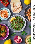Small photo of Assorted middle eastern dishes and meze. Tabbouleh salad, meat shawarma, hummus bowl, falafel, pita, bulgur, pomegranate, lemons. Arab cuisine. Party food. Middle eastern dinner. Ethnic food. Top view