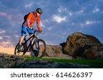 cyclist riding the mountain... | Shutterstock . vector #614626397