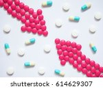 two pink arrows made by pills... | Shutterstock . vector #614629307