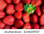 fresh ripe strawberries and one ... | Shutterstock . vector #614635937