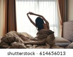 happy woman back view waking up ... | Shutterstock . vector #614656013