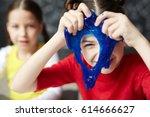 happy kid looking through hole... | Shutterstock . vector #614666627
