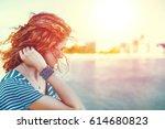 sad redhead woman looking away... | Shutterstock . vector #614680823