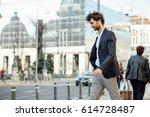 elegant and modern man walking... | Shutterstock . vector #614728487