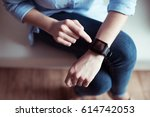 partial view of woman pointing... | Shutterstock . vector #614742053