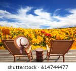 pair of wooden sun loungers... | Shutterstock . vector #614744477