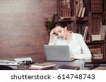young tired businesswoman... | Shutterstock . vector #614748743