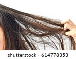 combing with brush and pulls... | Shutterstock . vector #614778353