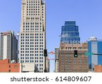 Small photo of KANSAS CITY, USA - MAY 21, 2016: Signature buildings of the Power and Light district, for instance the historic Power and Light building in front and the One Kansas City Place in the back.