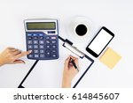 female accountant or banker... | Shutterstock . vector #614845607