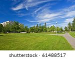City park with windy clouds - stock photo