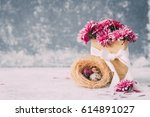 spring flowers with nest with... | Shutterstock . vector #614891027