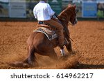 Stock photo a close up view of a rider sliding the horse in the dirt 614962217