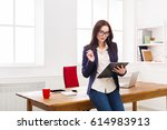 serious ceo businesswoman in... | Shutterstock . vector #614983913