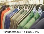 men suits on racks | Shutterstock . vector #615032447