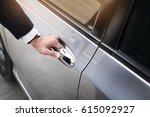 chauffeur s hand on handle.... | Shutterstock . vector #615092927