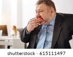 Small photo of Compulsive immoderate guy engulfing junk food