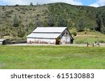 Old Wooden White Barn Stands O...