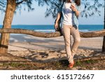 woman traveler sitting on a... | Shutterstock . vector #615172667