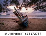 wreck boat on beach with sunnet ... | Shutterstock . vector #615172757