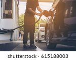 man is putting ngv  natural gas ... | Shutterstock . vector #615188003