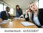 Small photo of Spiritless employee bored with work meeting presentation ignores manager boss