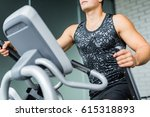 Small photo of Closeup portrait of muscular sportive man running using elliptical trainer during workout in modern gym