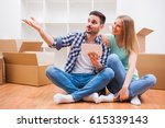 young couple is moving in their ... | Shutterstock . vector #615339143