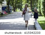 rear view of young mother...   Shutterstock . vector #615342233