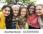 group of women socialize... | Shutterstock . vector #615355343