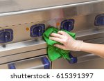 hand in protective glove with... | Shutterstock . vector #615391397