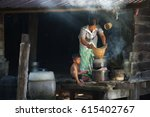 vietnamese mom and kid cooking... | Shutterstock . vector #615402767