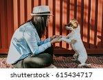 young beautiful woman playing... | Shutterstock . vector #615434717