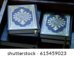 holy books of quran under soft... | Shutterstock . vector #615459023