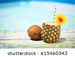 exotic pineapple cocktail near... | Shutterstock . vector #615460343
